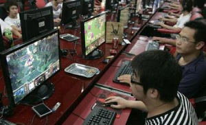 Customers play computer games at Internet cafe in Taiyuan
